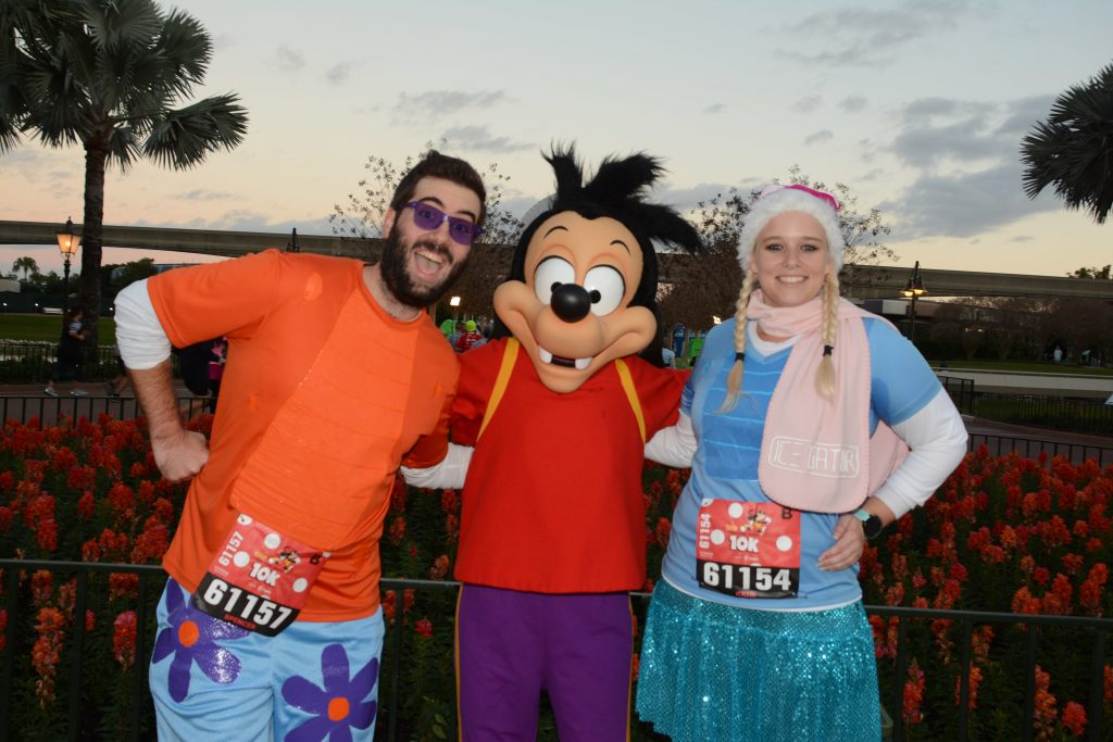Katie and Spencer meet Goofy's son Max while dressed as Ice Gator and Lagoona Gator from Disney's Water Parks.