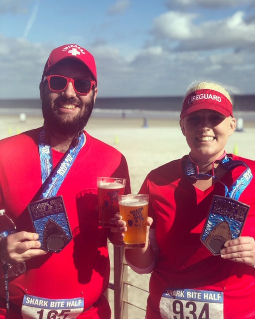 Spencer and Katie celebrate a great race with beer on the beach!