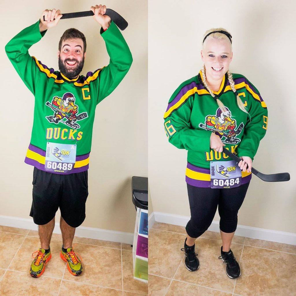 Katie and Spencer wearing Mighty Ducks jerseys