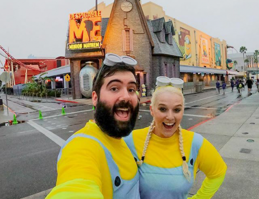 Katie & Spencer dressed as Minions in front of Despicable Me ride at Universal Orlando